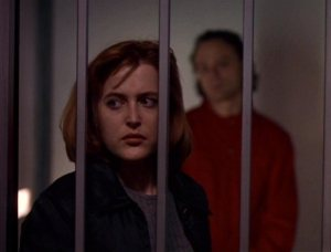 Dana_Scully_is_watched_by_Luther_Lee_Boggs